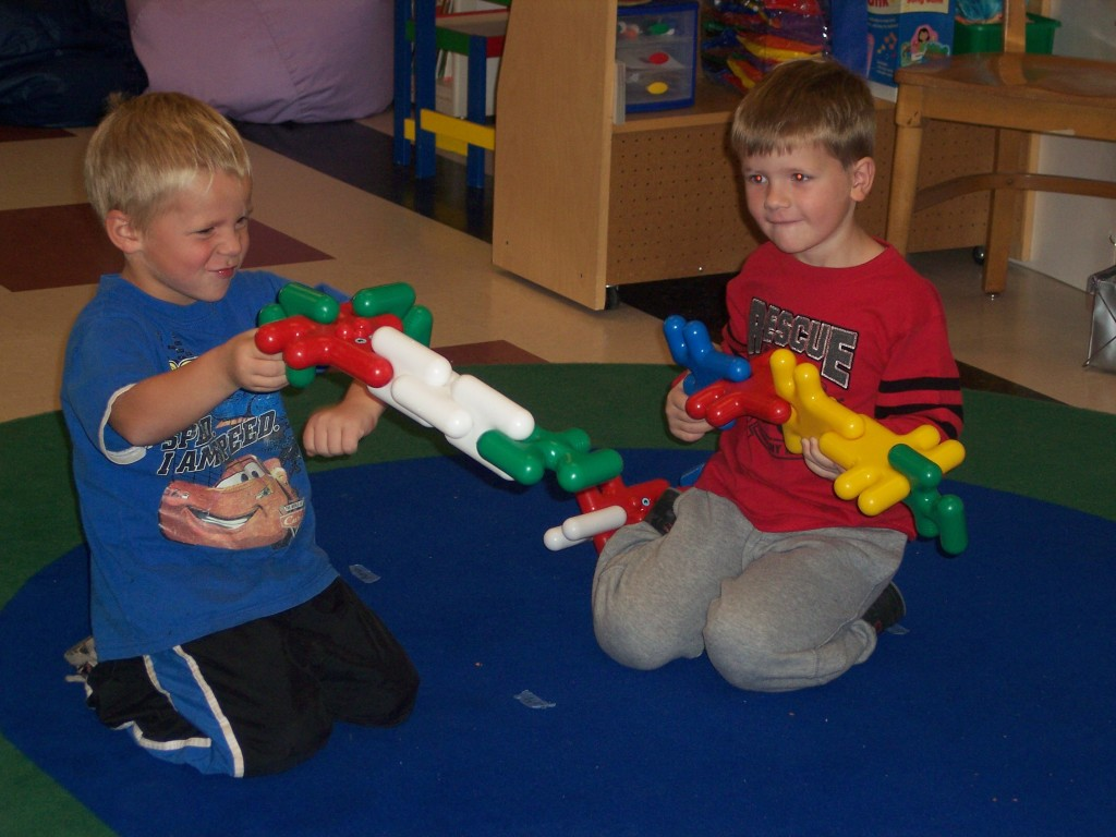Two boys playing with blocks